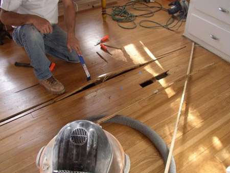 Laminate flooring fixing dents laminate flooring for Replacing hardwood floors
